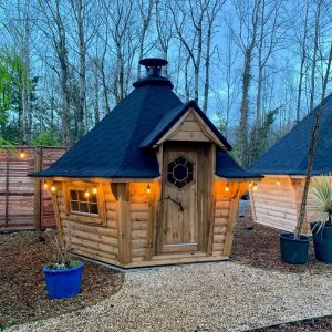7m Sloping Wall Grill Cabin on display at Carr Bank Garden Centre