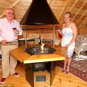 Cliff & Chris inside their 10m Sloping Wall Cabin with extension as featured in the Daily Mail!